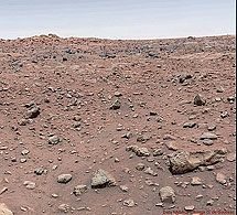 The first color image taken from the surface of Mars (left), snapped by Viking Lander 1 in 1976, shows Earth-like colors and a blue sky. Several hours later, NASA released an updated version (right) that astounded the world with its orange skies and red soil. This vision of a red Mars has influenced nearly every NASA image since and has become entrenched in pop culture through movies such as Total Recall and Red Planet.