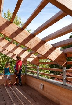 Minimalist Eco-Sustainable House Charms With a Green Sloped Wooden Pergola