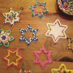 With a not-very-sick, high-energy kid home sick today, it's Chanukah decorations all day long. Perler beads! They're fabulous! (And we're reading The Cats of Tanglewood Forest, which is outstanding so far. And we're watching a movie, 'cause mama's gotta w