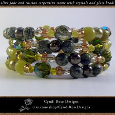 This fashionable beaded bracelet appears to be a series of colorful bangles but it's actually one coiled spiral. Olive jade gemstone rounds are reputed to bring good luck. Cracked green serpentine stone is said to be good for healing. The semiprecious gemstone beads coordinate with light and dark green glass pearls, clear crystals, olive green crystals, yellow green glass drop beads, and gold colored glass seed beads.  Strung on stainless steel memory wire. Beaded Jewelry, Beaded Bracelets, Unique Jewelry, Gemstone Beads, Seed Beads, Rose Design, Semi Precious Gemstones, Clear Crystal, Colored Glass