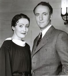 """Pauline Moran and Hugh Fraiser as Miss Lemon and Captain Hastings in """"Poirot"""". The dress she's wearing here is actually chocolat brown in colour, and a beautiful example of typical fashion (as is her hair, with the little curls). Agatha Christie's Poirot, Hercule Poirot, David Suchet, Tv Detectives, Miss Marple, Mystery Series, Press Photo, British Actors, Hercules"""
