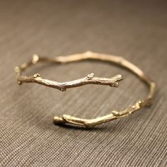 a sweet twig branch bracelet in gold