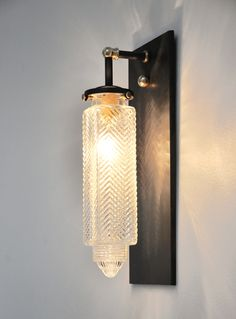Brilliant wall sconce which incorporates a vintage bullet shade to make a spectacular Art Deco statement..