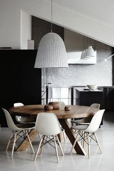 Simple round dining table with stunning hanging lighting in the center. So inspiring for a small family dining area. Top 10 Modern Round Dining Tables ♥ Discover the season's newest designs and inspirations. Visit us at www.moderndiningtables.net #diningtables #homedecorideas #diningroomideas @ModDiningTables