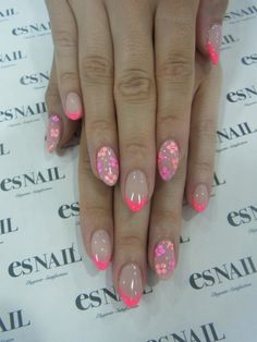 I like the length of these almond-shaped nails.  Neon Flowers Manicure www.gmichaelsalon.com