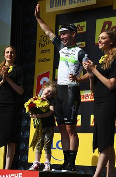 #TDF2016 Stage winner Mark Cavendish of Great Britain and Team Dimension Data celebrates on the podum with daughter Deliah after victory during Stage One of...
