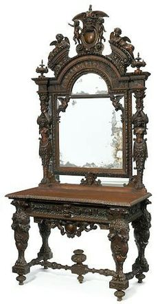 A CONTINENTAL RENAISSANCE REVIVAL CARVED WALNUT CONSOLE AND MIRROR  LATE 19TH CENTURY.