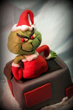 The Grinch is made from Rice Krispie treats, covered in fondant. The cake is a red velvet cake, iced in fondant. This cake made it onto the Food and Wine website, which I thought was awesome: Grinch Cake, Grinch Party, Cupcakes, Cupcake Cookies, Unique Cakes, Creative Cakes, Beautiful Cakes, Amazing Cakes, Cake Pops