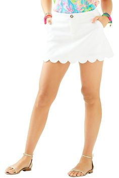 The Colette Skort is a white skort with a scalloped hem. This skort is the perfect alternative to white shorts this season. From knit to silk and tanks to tunics, this skort will suit all of your gorgeous Lilly tops this season. Skort With Scallop Hem. Jumbo Pique (100% Cotton). Machine Wash Cold. Imported. Colette Scallop-Hem Skort by Lilly Pulitzer. Clothing - Shorts Sandestin Golf and Beach Resort, Florida