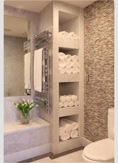 Love this idea for towel storage...maybe with millwork?