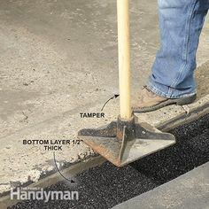 How to Fix a Sinking Driveway: Tamp down the first layer of cold patch to fill in the sunken section of driveway. http://www.familyhandyman.com/smart-homeowner/diy-home-improvement/how-to-fix-a-sinking-driveway/view-all