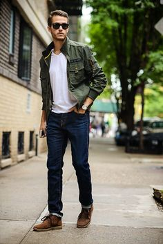 Military jacket, white tee, denim and ray bans.