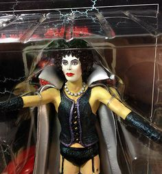 "Rocky Horror Picture Show Dr. Frank N Furter Vital Toys 2000 8 inch figure.  Realistically detailed drag figure of Tim Curry as cult movie icon Dr. Frank N Furter from 1970s classic The Rocky Horror Picture Show movie. Discontinued 8-inch figure exclusive Limited Edition created by Vital Toys in 2000. Articulation and design complete with ""Boss"" tattoo, corset with purple trim and fishnet stockings. This figure includes cape and display base."