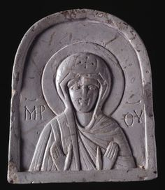 Relief icon; pale grey-green steatite; rounded at the top and square below; bust of the Virgin, her mantle drawn over her head, with St Andrew's cross on it; her hands held in front with palms outwards, inscription either side of her. Culture/periodMiddle Byzantine term details Date12thC FindspotFound/Acquired: Tartus(Asia,Middle East,Levant,Syria,Central Syria,Tartus (governorate),Tartus)