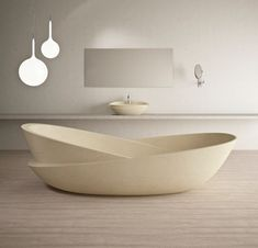 At first glance, the Ciotole Tub looks like two oblique basins, but this sculptural design is actually made from a single piece of masterfully carved beige marble.