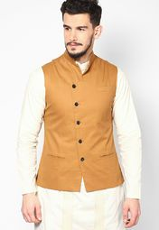 Look your best at a party tonight wearing this mustard yellow coloured waistcoat for men from the house of I Know. Made from cotton, this regular-fit waistcoat will keep you comfortable all day long. Team it with black coloured trousers and get ready to fetch compliments.