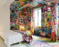 A hotel in France. Half in white, half in graffiti.