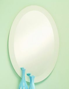 341 – Oval frameless mirror features a high polished edge with a frosted border. 24″ wide, 36″ high and 3/8″ deep.