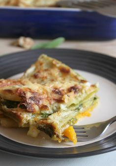 cheesy roasted squash lasagna with spinach and walnut pesto