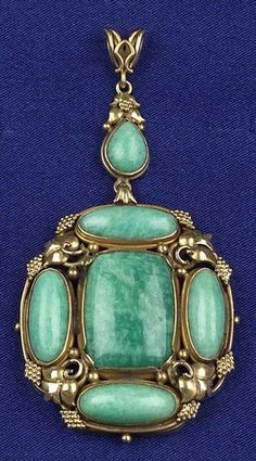 Arts & Crafts 14kt Gold and Amazonite Pendant, with bezel-set amazonite cabochons within a gold foliate frame.