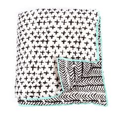 ARRO Home: •  Reversible cotton single quilt with polyester wadding  •  Painted Crosses with Painted Chevron on reverse   •  Black design on white base with contrasting green piping border  •  Dimensions: available in single and queen sizes