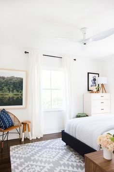 Crisp and clean bedroom with midcentury-inspired accents and bold photography.