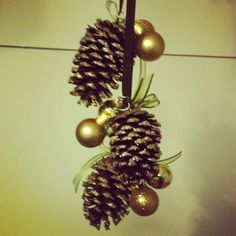 Holiday pinecone craft. Glitter/ribbon/hot glue/ornaments