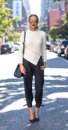 a cream ribbed sweater with a asymmetrical cut and hem back to a jumper pant and pumps. love the shoulder bag and pump, not to mention the sunglasses