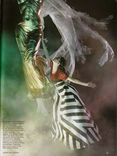 "Shalom Harlow dancing in ""Le Cirque"" for Vogue UK, January 2007. Photograph by Javier Vallhonrat. ""With a scarlet tee, Giles' dramatic striped taffeta dress is spellbinding. Sequined top, from £990, Givenchy, at Harvey Nichols and Selfridges. Striped silk gown, worn as skirt, £2,450, Giles, at Harvey Nichols."""