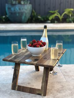 Never spill your wine again! Our signature Folding Wine Tables are the perfect accessory for all picnic lovers. Finally a place to keep your wine bottle and glasses safe and keep your delicious food off the ground.