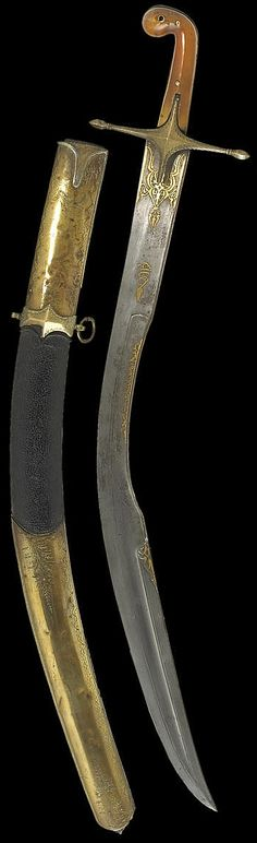 The short version of the Ottoman kilij sometimes known as ''pala'', with deeply curved wide blade and 'T' spine, used from the early 17 C. for more than 300 years well into the 20th C, T-section spine blade extending to the yelman, decorated in gold overlay with panels of arabesques and three panels of inscriptions. Brass guard engraved with a tendril. Grip scales of translucent brown horn. Leather-covered scabbard, the long brass mounts engraved with florals. 27 inch. 18th to 19th century.