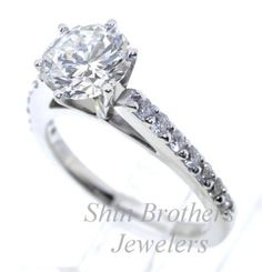 11003839 14K White Gold GIA Certified Diamond Engagement Ring Center Diamond Weight : 1.45ct. Color : G Clarity SI1  Side Diamond Weight: 0.32ct.  GIA Certificate # 2155766804  Total Weight : 4g  Model # ENS1423