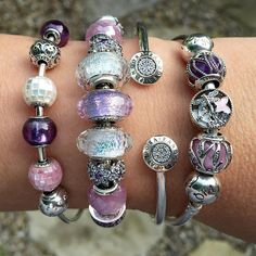 Wearing pretty pinks and purples for work today. The silver is brilliant in this combo of colours.  #officialpandora #theofficialpandora #purplelove #motherofpearl #beauties #pink #crystals #silverbangles #pandorabeads #myarmparty #forgetmenot #spacers #shimmer #murano #glassbeads #whiteglass #pandoraaddict #lovemyjob @theofficialpandora