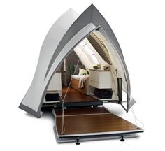Want luxury outdoor living? Have a go in this Opera Trailer Tent, where life on wheels doesn't get more stylish.