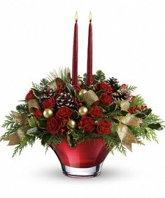 TELEFLORA'S HOLIDAY FLAIR CENTERPIECE - A real show stopper - this holiday arrangement is delivered in a custom crafted hand-blown glass bowl with 2 tapers. Will leave a lasting impression on your family and guests!