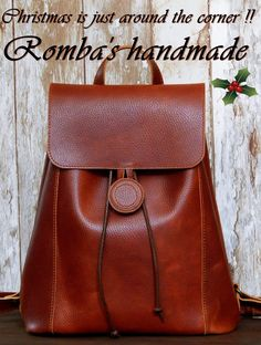 "Win an elegant handmade leather backpack. Enter to our f/b page ""Handmade leather sandals & bags Romba's"". Super Χριστουγεννιάτικος Διαγωνισμός ""Christmas is just around thw corner"" και απολαύστε το στυλ και την ποιότητα του χειροποίητου. Μπείτε στη σελίδα μας στο f/b και διεκδικήστε ένα χειροποίητο δερμάτινο backpack ..... f/b page : Δερματινα χειροποιητα σανδαλια & τσαντες Romba's"