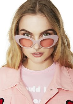 Crap Eyewear The Wild Gift Milky Sunglasses purr kitty purrrrrr….these exclusive Hello Kitty collab sunniez have milky pink glitter frames, gold Kitty head logo charms and pretty pink lenses.