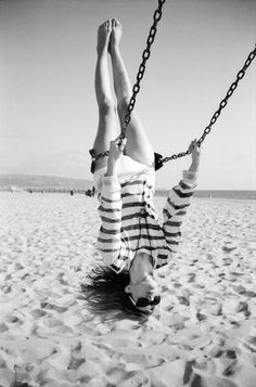 I love swinging like this - I had forgotten until this picture reminded me.  I will include a sturdy, adult-sized swing in my yard!  By the way, how is her pendant staying in place? I would think it should be dangling towards the ground when she's at that angle!