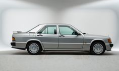 MERCEDES 190E COSWORTH 2.5 W201 (1989) –  The introduction of the special edition 2.3-16v model in 1983 came from Mercedes Benz desire to re-enter motorsport with a direct factory team after their retirement following the tragic events at the 1955 Le Mans race. Enlisting the help of the British engineering firm Cosworth Mercedes had plans to take the 190 to the rally circuit, however the project suddenly became unrealistic when Audi released the Quattro.