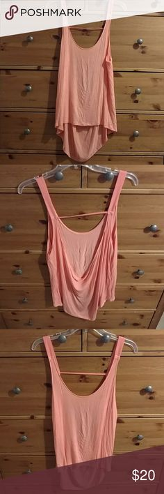 UO Silence&noise coral low back loose tank 🐠🌊 Urban outfitters Silence and noise coral low back loose tank Gently used Very SOFT, super delicate The open back is sexy and comfy at the same time Can be worn as tunic over bikini Size small but it is oversized and can definitely got medium or large Urban Outfitters Tops