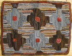 This geometric rug is designed and hooked to look like an old vintage rug, with erratic rows of hooking, splotchy colorations, hit or miss elements, out of square edges, and timeworn colors. The si…