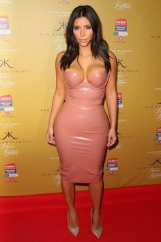 Today is Kim Kardashian West's 35th birthday and though she's made her mark on the fashion scene in a serious way in recent years, counting Bamain's Olivier Rousteing and Givenchy's Riccardo Tisci among her closest designer friends, sometimes it seems as if the selfie pro just wants to wear her birthday suit. From spandex jumpsuits to tight pencil dresses to—of course—her totally sheer feathered Met Gala gown, Kardashian West certainly rocks her fair share of neutral or nude p...
