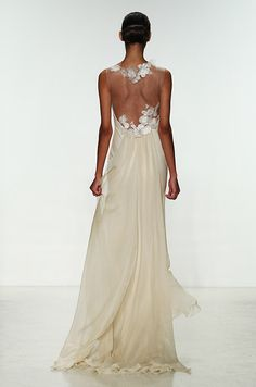 The illusion back of this cream color wedding dress is very romantic. Amsale, Spring 2015