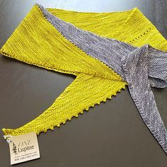 This asymmetrical shawl is worked in garter stitch with a simple k2tog and yo row spaced as desired or to make a clean transition between colors. I cast this on with 1/3 skein of gray and then pared it with a mossy chartreuse but just about anything could work here, from our Wee Skeins to a hand painted yarn. It is also a great stash busting project for those leftover bits and bobs.