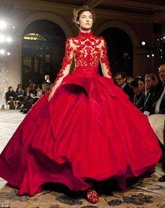 Red or dead: A Marchesa model struts down the catwalk in a brilliant crimson gown