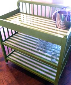 Repurposed baby changing table to rolling drink cart!  Add casters, paint, fabric and plexi shelves and viola... it's much more fun!