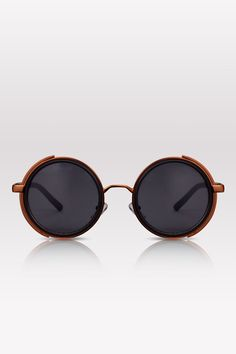 Functional fashion meets sci-fi chic. Vintage round frames get a steampunk rap with built-in side shields.