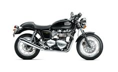 """Thruxton. Named after the race track where Triumph ruled the roost and inspired by the famous """"Ton Up Boys"""" of the 60s. The Thruxton is our sportiest classic, an authentic café racer delivering that unique Triumph riding experience. Low rise bars, sporty riding position, 18 inch spoked wheels, megaphone style exhaust and a modern 865cc parallel-twin engine. It stirs the heart for those around at the time and for those who seek the classic sporty retro cool."""