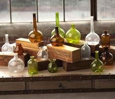 Tincture and apothecary bottles on branded wood / cardboard platforms to afford a more vertically activated display of product. MK