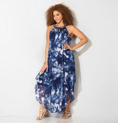 Get a worldly island look with lightweight chiffon maxi dresses like our plus size Smudge Necklace Maxi Dress available in sizes 14-32 online at avenue.com. Avenue Store